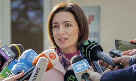Maia Sandu speaks to the media after casting her vote in Chisinau.