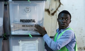 An Independent Electoral and Boundaries Commission official stacks ballot boxes