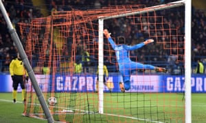 Roma's Brazilian goalkeeper Alisson fails to keep out compatriot Fred's free-kick.