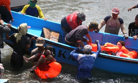 Rescuers assist survivors arriving in West Java in 2013 after an Australia-bound boat carrying asylum-seekers sank off the Indonesian coast, leaving at least nine dead.