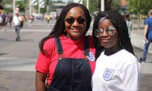 Female football fans attending an England match at Wembley.