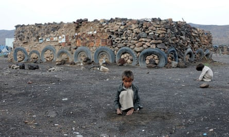 Darwan Refugee Camp in YemenSANAA, YEMEN - APRIL 11 : Children crouch at Darwan refugee camp in Amran north of Sanaa, Yemen on April 11, 2018. Yemeni families, displaced by the clashes and airstrikes by Saudi Arabian-led coalition, face difficulties living under tough conditions. Yemen faces political instability due to the armed takeover by the Houthis since 2014 as they control some regions including Yemeni capital Sana'a. (Photo by Mohammed Hamoud/Anadolu Agency/Getty Images)