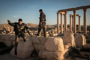 Syrian Army soldiers seen at the Temple of Bel, in Palmira, Syria