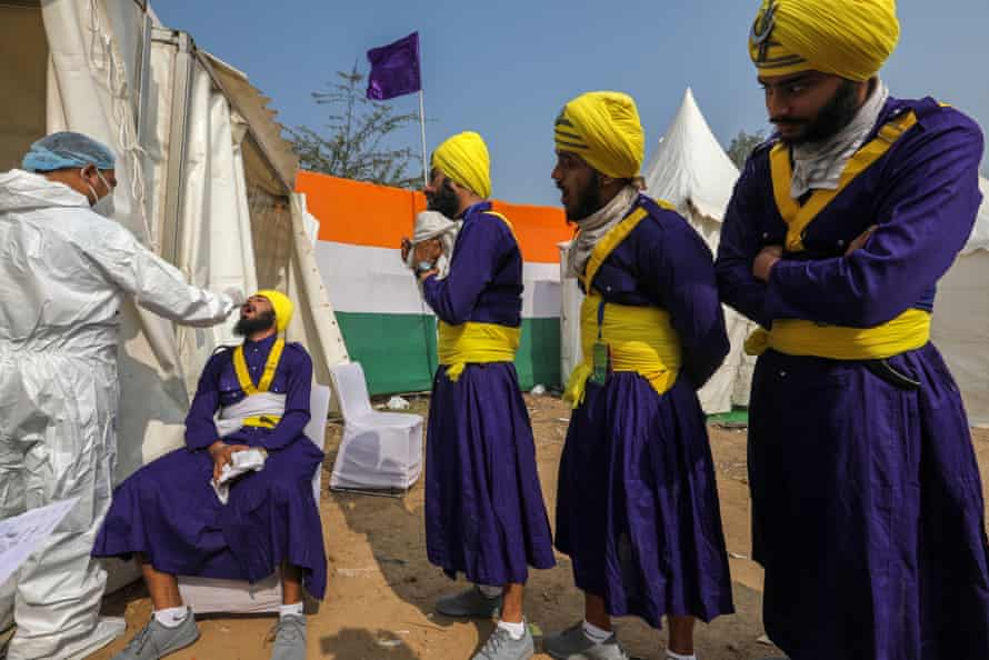 Indian artists being tested for Covid-19 before taking part in the Tableau press preview ahead of Indian Republic Day celebrations in New Delhi, which took place on Tuesday