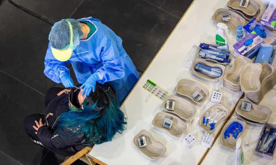 A health workers carries out a coronavirus test in Logrono city, Spain.
