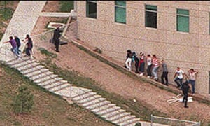 Students flee Columbine high school in the middle of the shooting.