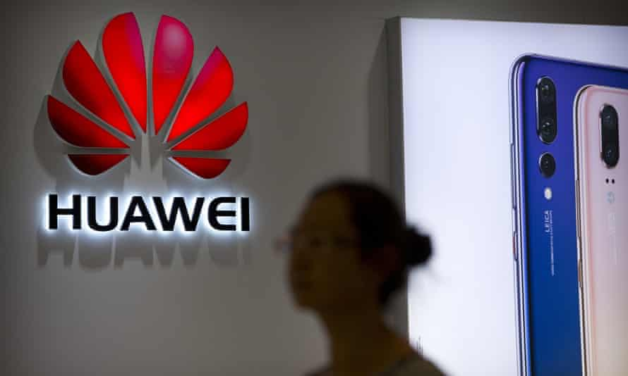 A shopper walks past a Huawei store at a shopping mall in Beijing