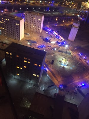 Aerial shot of tower blocks and emergency vehicles in The Aftermath Dislocation Principle