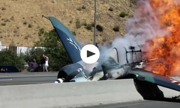 Mock WWII fighter plane crashes into Los Angeles-area freeway – video