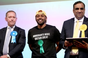 The former mayor of Sheffield Magid Magid (centre) is elected as a Green party MEP, in results announced at Leeds town hall