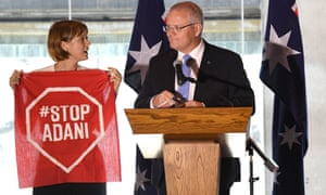 An anti-Adani coalmine protester interrupts a Scott Morrison speech