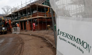 Builders construct homes on a Persimmon development