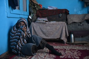 Hanifa sits on the floor of the house in Kabul