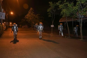 Bangkok, Thailand Soldiers wearing protective clothing and spraying disinfectant to combat Covid-19 advance across a road in the capital