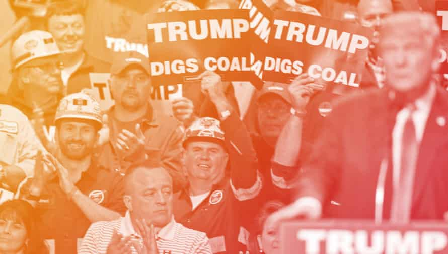 Coal miners wave signs as Republican presidential candidate Donald Trump speaks during a rally in Charleston, W.Va.