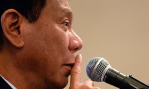 Close-up of Rodrigo Duterte, the Philippines' president-elect, with a finger to his lips