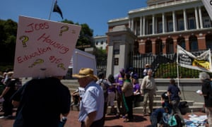 Protesters at the Massachusetts State House in Boston calling for a minimum wage rate of $15 an hour.