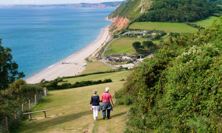 Walkers on the South West Coast path approaching Branscombe in Devon.