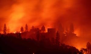 Flames from the Camp fire burn near a home near Big Bend, California.