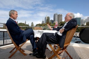 The then US president, George W Bush, and the then Australian prime minister, John Howard, on Sydney Harbour for Apec in 2007