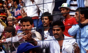 An Algerian fan waves a bank note showing their disgust at what they think is a fixed drawn match between the two teams West Germany v Austria World Cup 1982 played in Gijon.