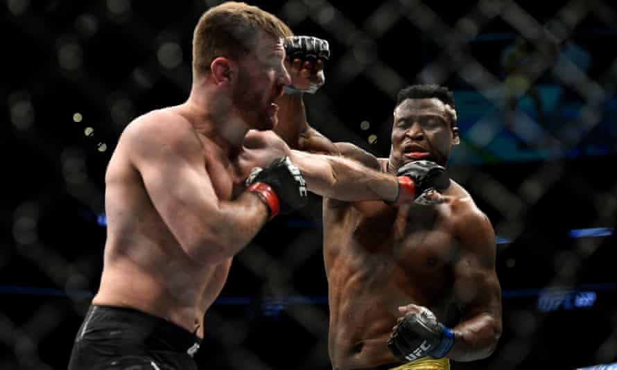 Stipe Miocic punches Francis Ngannou during their title fight