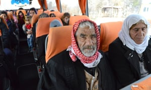 Yazidis refugees on a bus in southern Turkey.