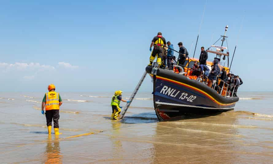 A second boat load of 42 migrants, some of which are children arrive onto UK shores onboard the Dungeness RNLI lifeboat after being intercepted by Border Force off the coast.