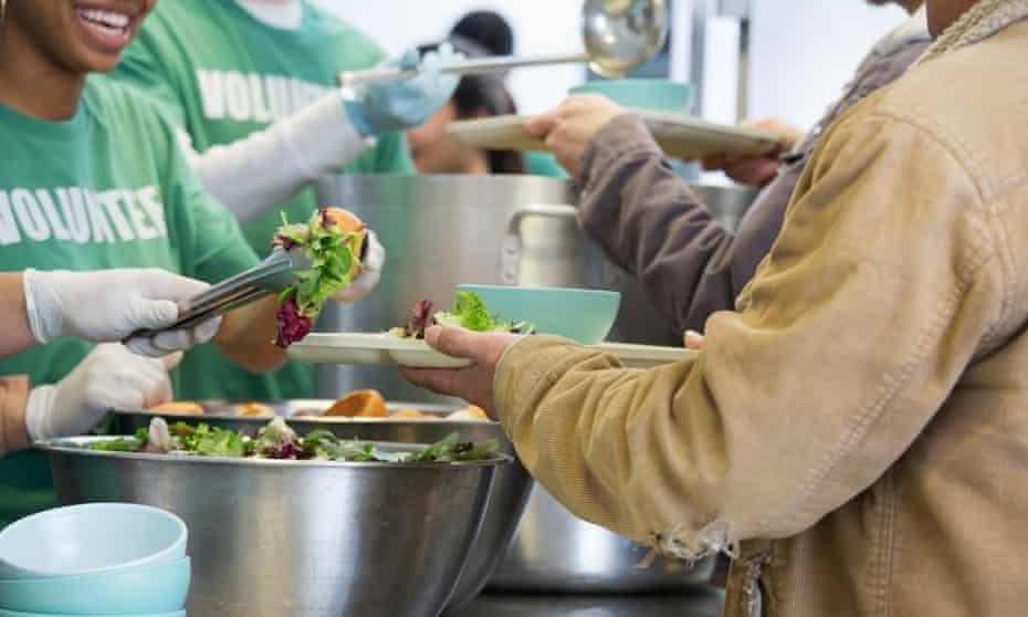 Volunteers working in soup kitchen