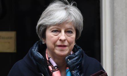 Theresa May leaves Downing Street in London