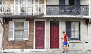 A man walks past some residential houses in Sydney