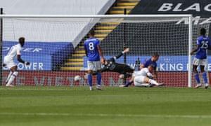 Ross Barkley guides the ball past the Leicester goalkeeper Kasper Schmeichel to score Chelsea's winner