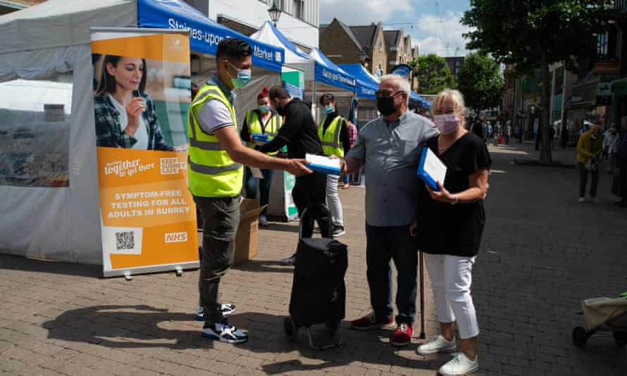 Free NHS lateral flow test packs being given to shoppers in Staines-upon-Thames