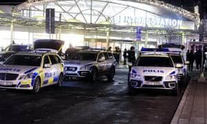 Swedish police arrive on the scene as masked men target refugees and migrants in Stockholm.