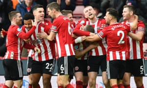 John Lundstram of Sheffield United celebrates with his team mates after scoring his team's second goal.