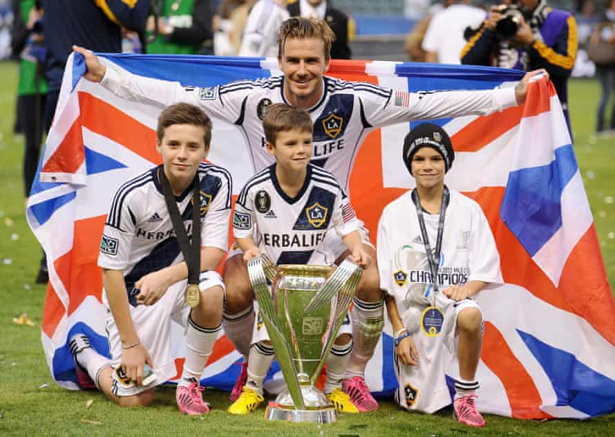 David Beckham poses his sons after winning MLS Cup in 2012