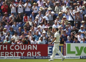 Mitchell Johnson being applauded and cheered when he reached his century (0/100) , he doffed his cap and kissed the badge in appreciation.
