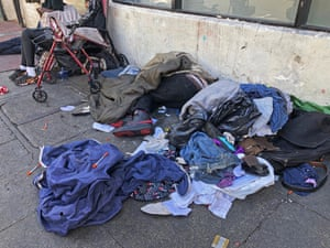 A street in San Francisco's Tenderloin district is a jumble of sleeping people, discarded clothes and used needles.