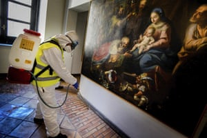 A worker sprays disinfectant in a museum at Maschio Angioino medieval castle in Naples