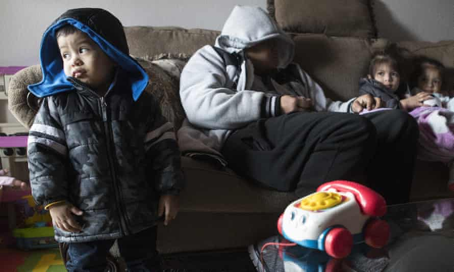 Eithan Colindres and his family wear winter coats indoors after power cuts in Houston, Texas.