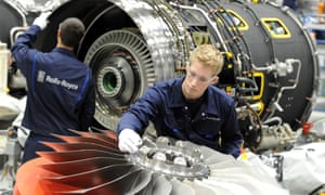 Rolls-Royce workers with jet engine