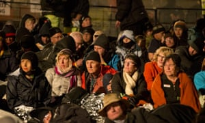 Crowds watch the entertainment at the Anzac commemorative site in the late evening of 24th April.