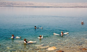 Jordan, Dead Sea, Bathers floating due to high salinity