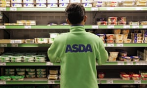 Asda employee tidying shelves in a supermarket