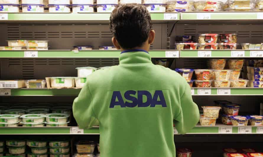 Young employee filling the shelves at Asda supermarket