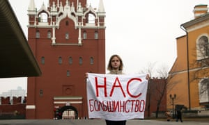 An activist holds a sign that reads 'We are the majority' in a protest outside the Kremlin on International Women's Day.