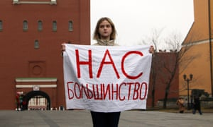 An activist holds a sign reading 'We are the majority' outside the Kremlin on International Women's Day.