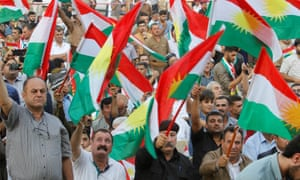 People wave flags to show their support for the forthcoming independence referendum in Kirkuk, Iraq.