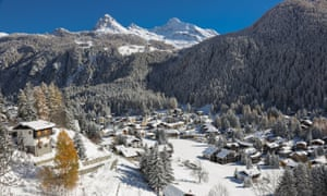 Champoluc village and wooded mountains
