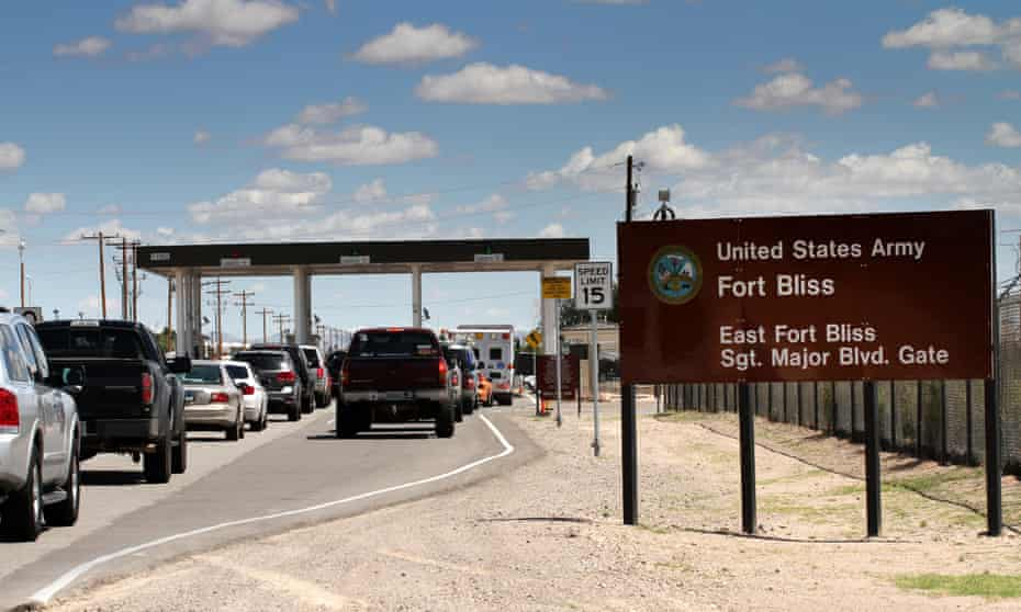 Cars wait to enter Fort Bliss in El Paso, Texas.